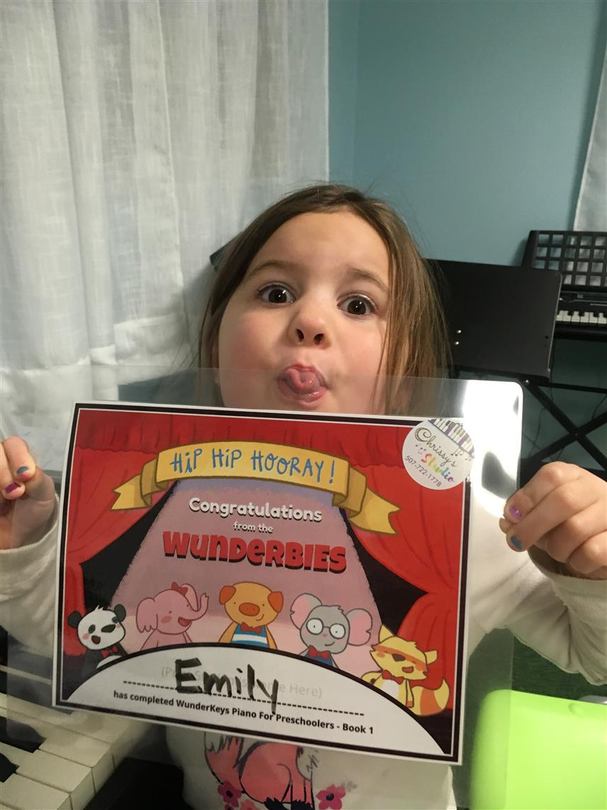 Emily has finished her first WunderKeys book!