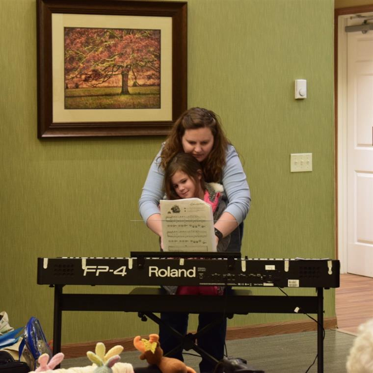 Emily needed some help from Mom getting started on Jolly Old St Nicholas on the piano.