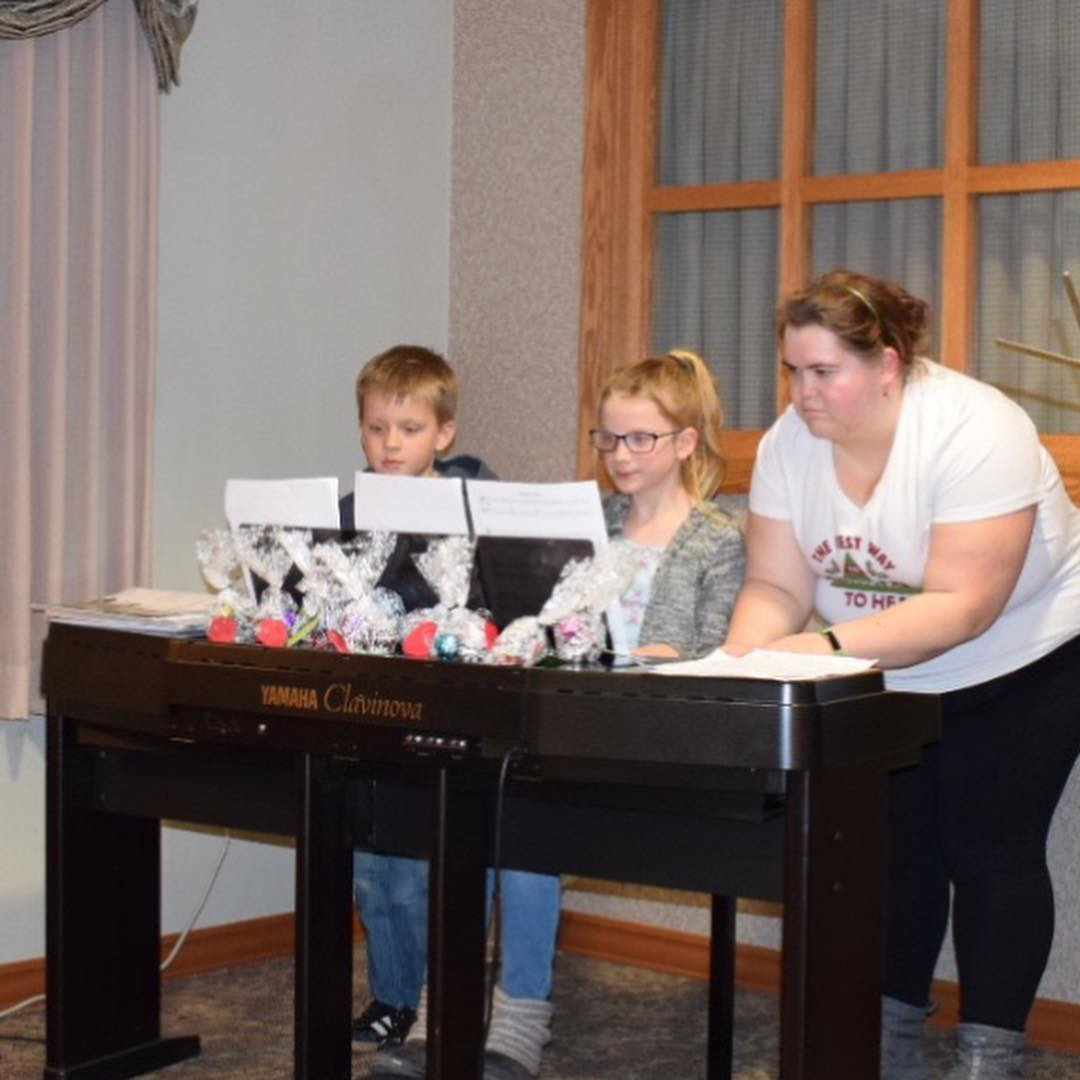 "Graham, Abby, and Chrissy are ""Jingle Bell Rock""-ing away in a piano trio!"